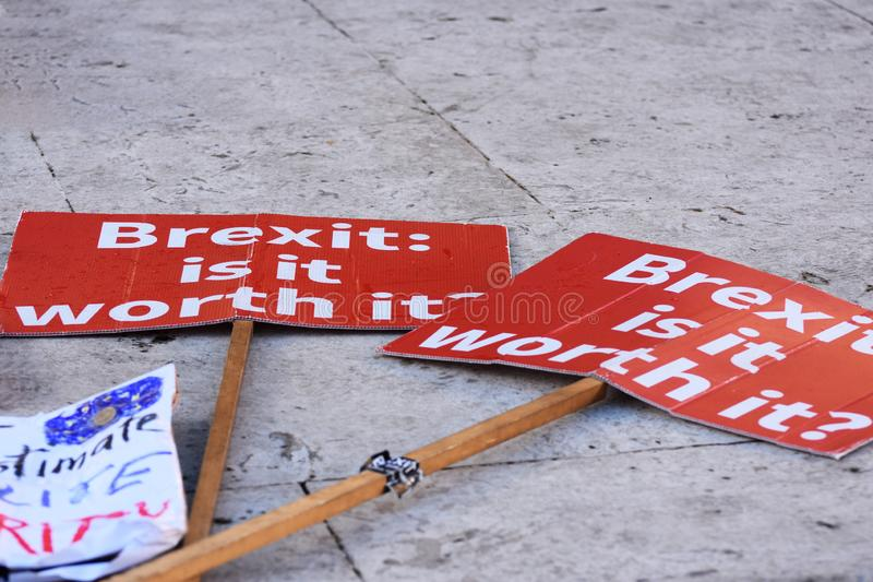 Anti Brexit Signs In Westminster London, UK Jan 2019. London, UK, January 17 2019. Protestors` anti Brexit / Pro Remain in EU sign lying on the pavement / royalty free stock photography