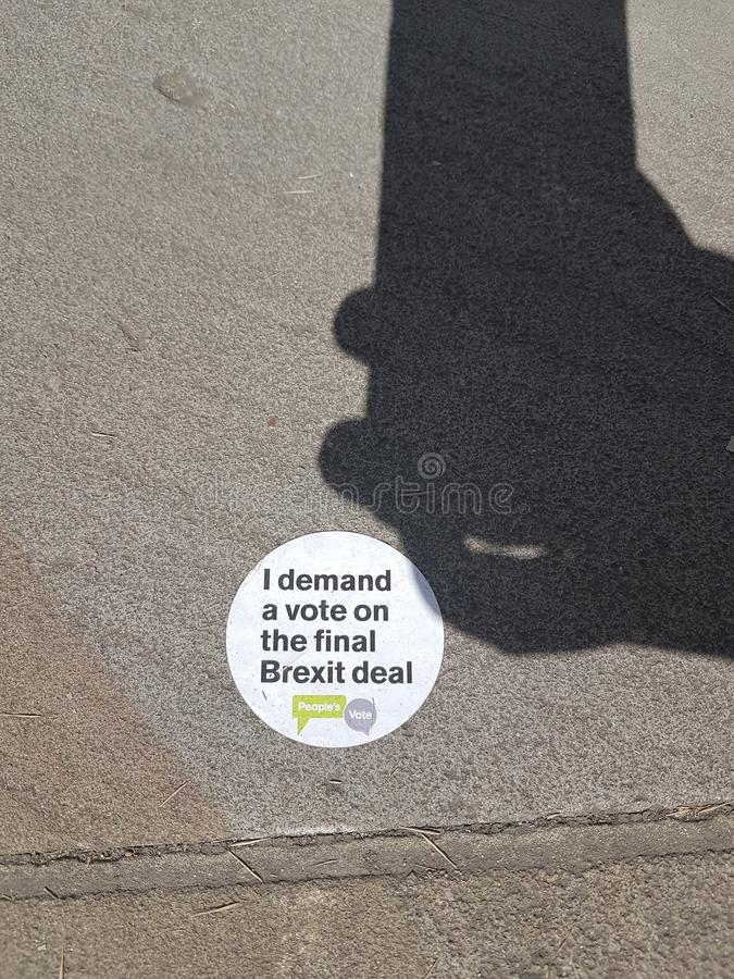 Anti-Brexit sticker left in Parliament Square, London. Anti-Brexit sticker left by protesters in Parliament Square during the People`s March that gathered 100 royalty free stock image