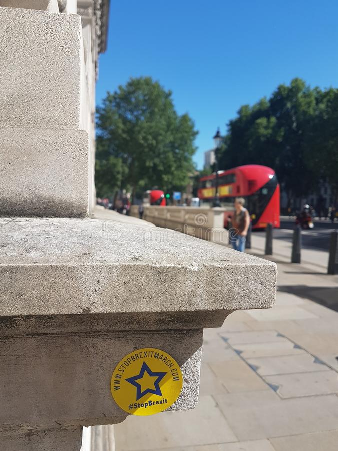Anti-Brexit sticker near Parliament Square, London. Anti-Brexit sticker left by protesters during the People`s March that gathered 100,000 people to march stock photos