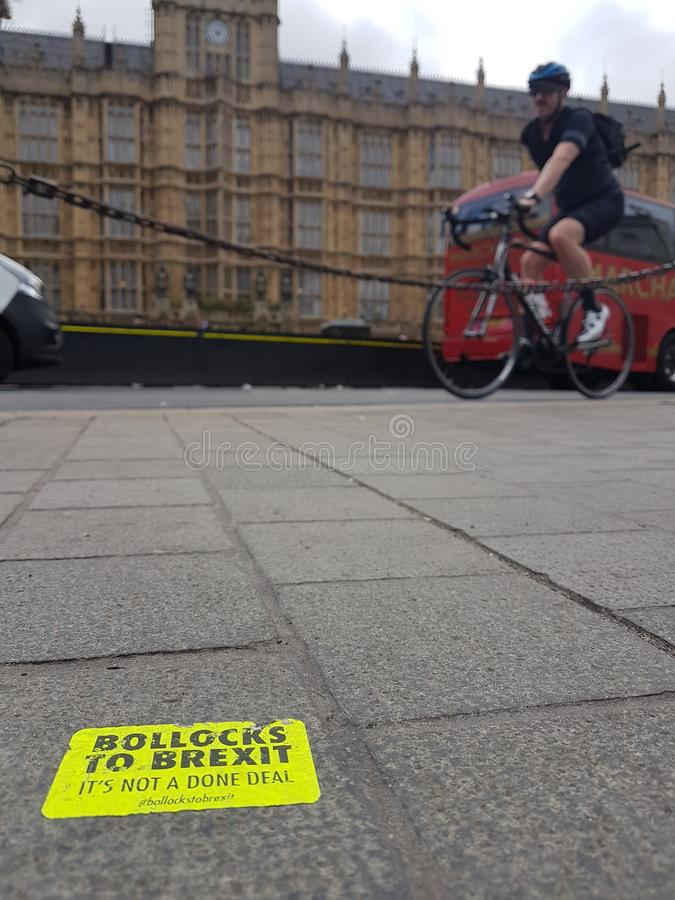 Anti-Brexit sticker on Westminster Bridge. Anti-Brexit sticker glued to the pavement on Westminster Bridge, by the Palace of Westminster, the UK Parliament in stock photo