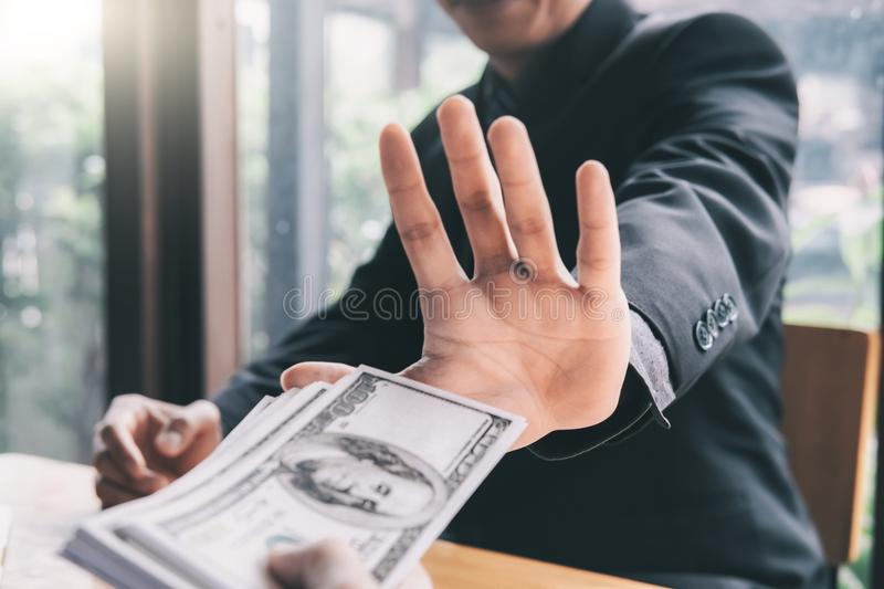 Anti bribery and Anti Corruption concepts. Businessman refusing bribe royalty free stock images