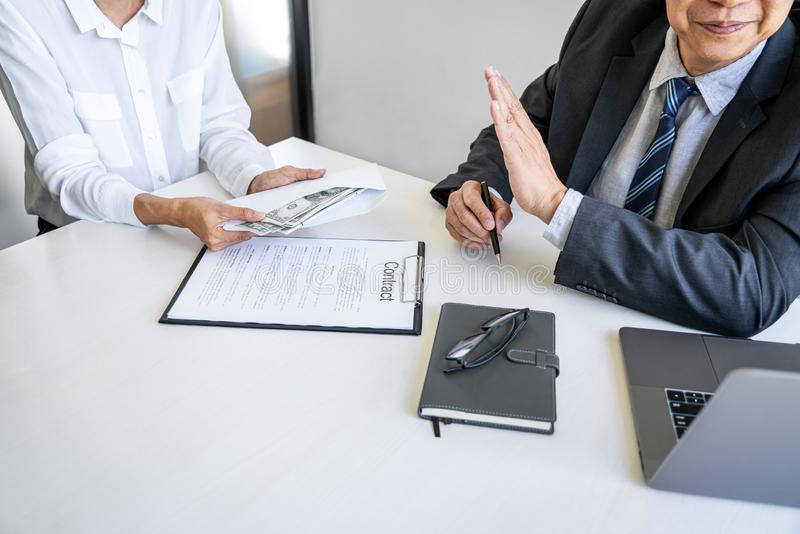 Anti Bribery and corruption concept, bribe in the form of dollar bills, consultant refuse receive money from business woman while stock photography