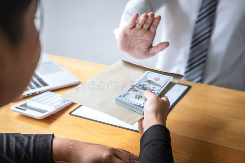 Anti bribery and corruption concept, Business man refusing and don`t receive money banknote in envelope offer from business peopl. Anti bribery and corruption royalty free stock photography