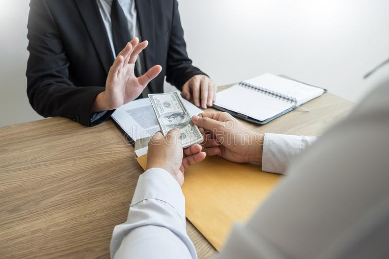 Anti bribery and corruption concepts, Businessman refusing or rejecting the money to take bribe from partner.  stock photo