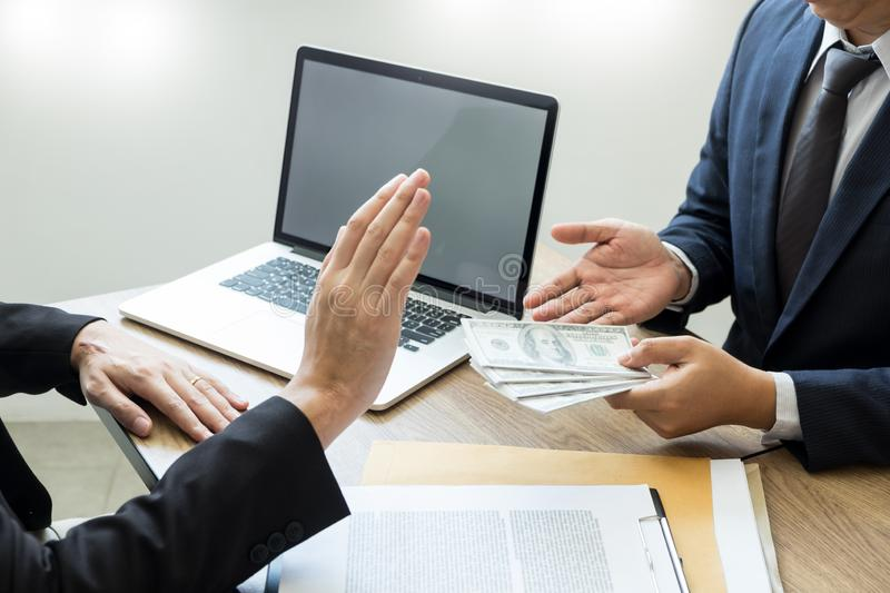 Anti bribery and corruption concepts, Businessman refusing or rejecting the money to take bribe from partner.  stock photos