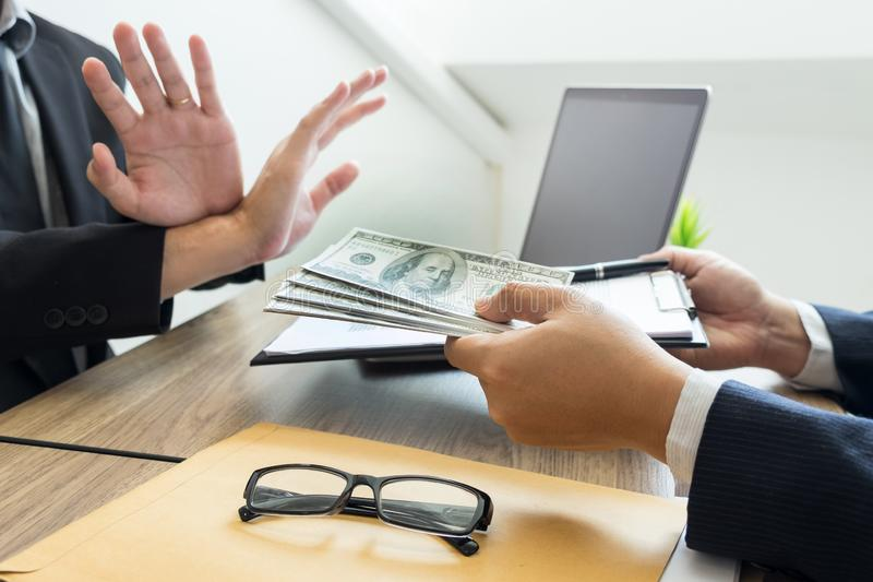 Anti bribery and corruption concepts, Businessman refusing or rejecting the money to take bribe from partner.  stock image