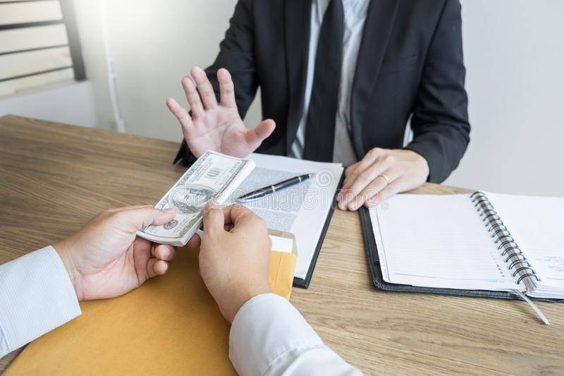Anti bribery and corruption concepts, Businessman refusing or rejecting the money to take bribe from partner.  stock images