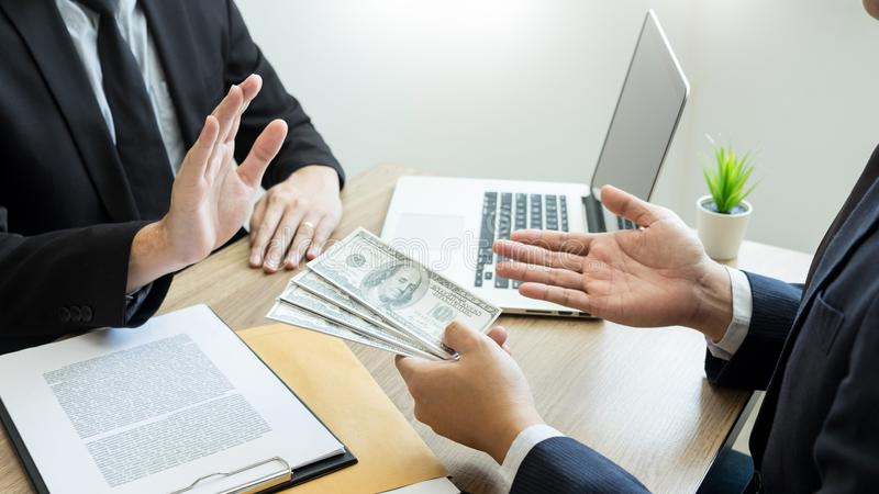 Anti bribery and corruption concepts, Businessman refusing or rejecting the money to take bribe from partner.  royalty free stock images