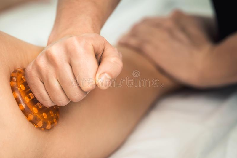 Anti-cellulite massage of hips in spa. Concept of healthy lifestyle. stock photos