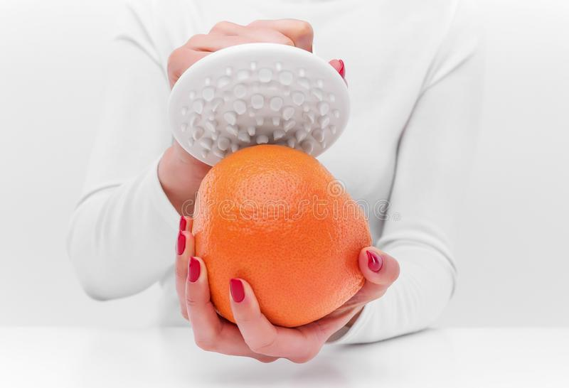 Anti-cellulite massager and orange. stock image