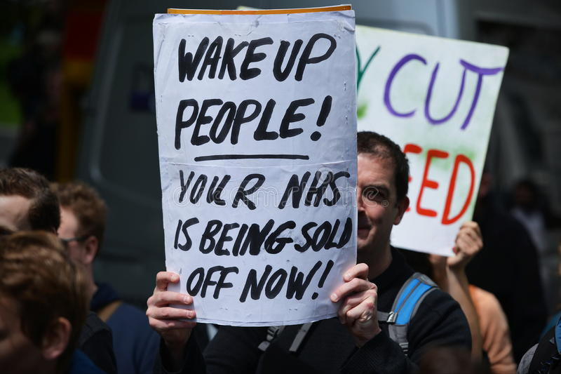 Anti Cuts Rally in London. Protesters rally against public sector spending cuts following the re-election of the Conservative party on May 30, 2015 in London, UK royalty free stock image