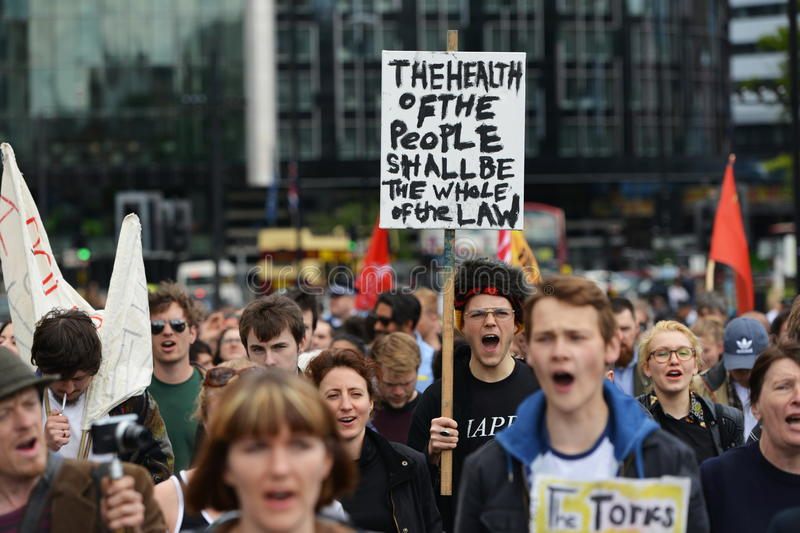 Anti Cuts Rally in London. Protesters rally against public sector spending cuts following the re-election of the Conservative party on May 30, 2015 in London, UK stock images