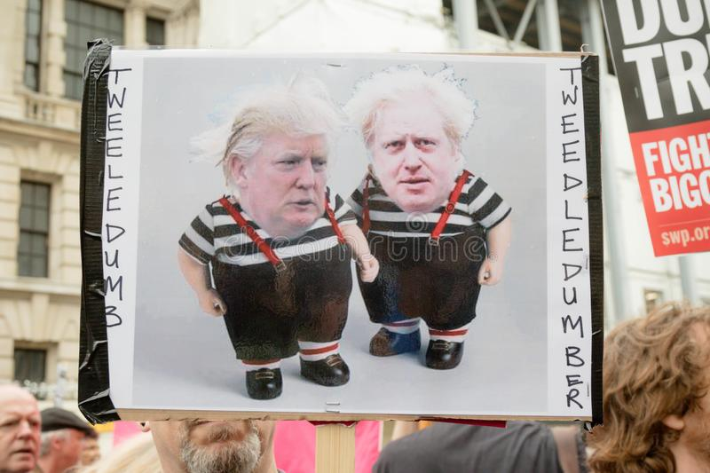Anti Donald Trump Protesters in Central London. London, United Kingdom, June 4th 2019:- Placards held by Anti Trump protesters in Whitehall against the State stock photos