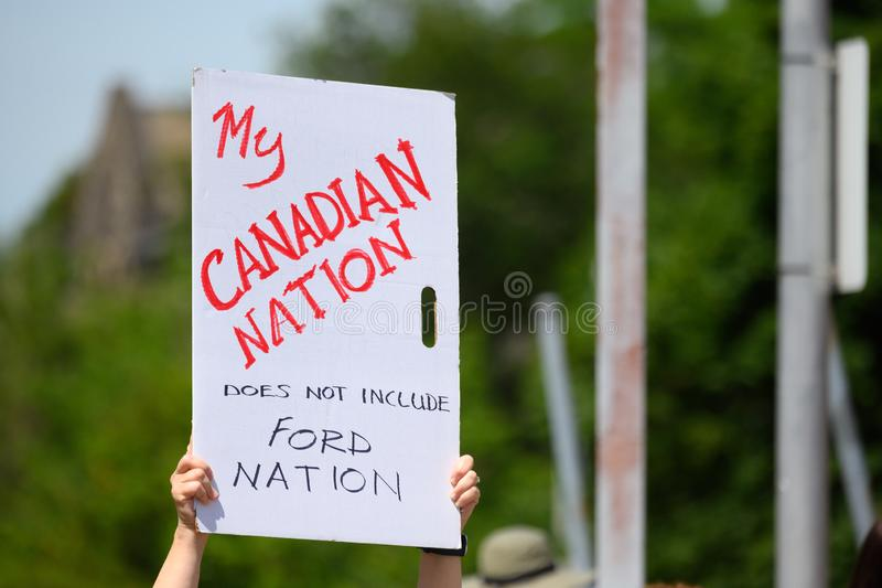 Anti-Doug Ford Protest Sign on Canada Day. A demonstrator shows distaste for Ontario premier Doug Ford at a Canada Day event he cancelled but was taken over by royalty free stock image