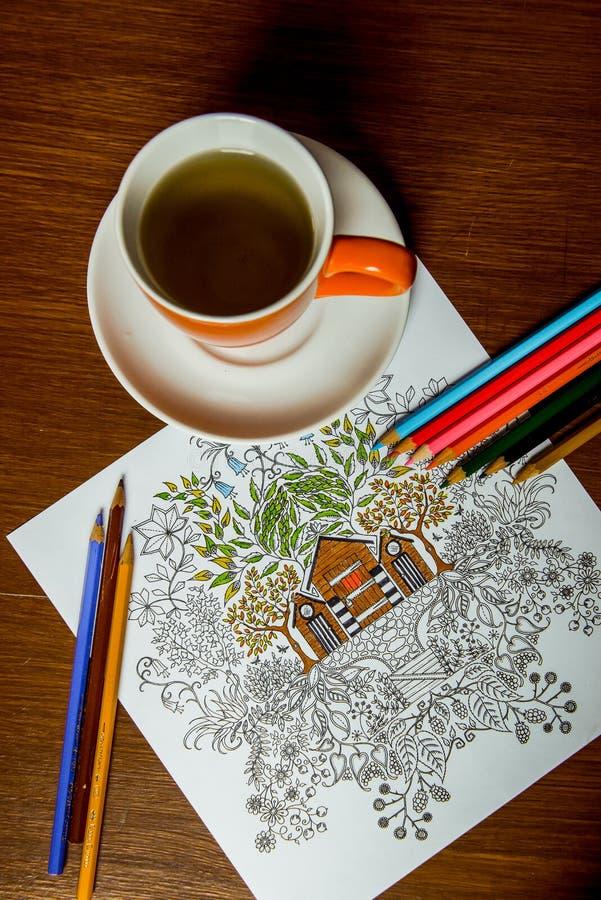 Anti-Druckmalbuch im Zeichnungsprozeß stockbild