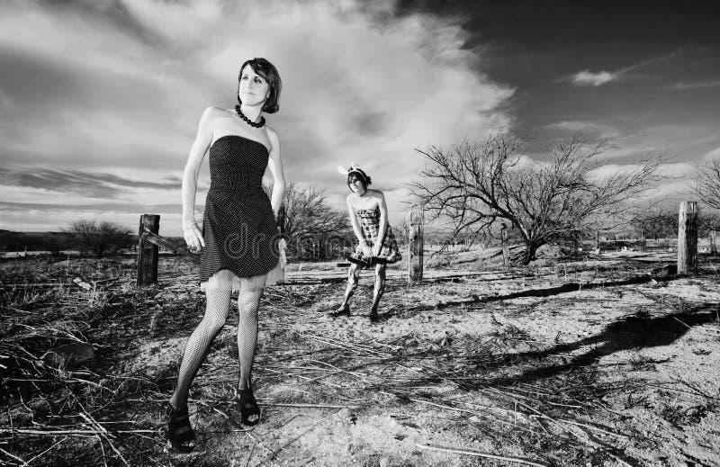 Anti-Fashion Girls. Two punk girls posing in a rural setting stock image