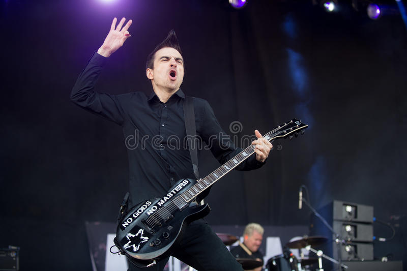 Anti-flag. Singer and guitarist Justin Sane of Anti-flag during performance at festival Rock for People in Hradec Kralove, Czech republic, July 5, 2016 royalty free stock photo