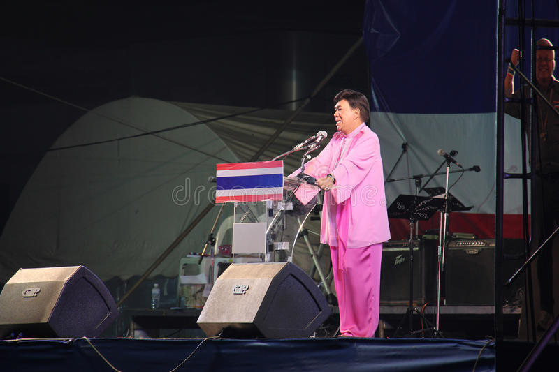 Anti-Government Protest. Bangkok, Thailand - January 26, 2014: Dr. Seri Wongmontha, celebrity protest leader of the anti-government protests, is speaking to the stock photos