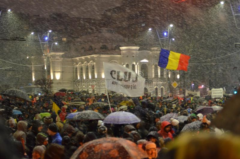 Anti government protests in Bucharest in inclement weather. Bucharest, Romania - January 20, 2018: People gathered in University Square, in the center of the stock photo