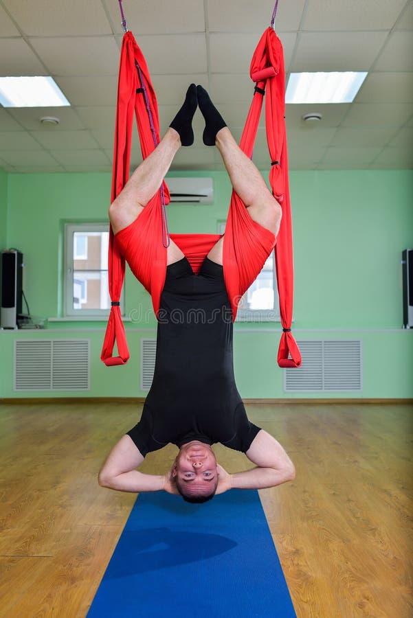 download anti gravity yoga man doing aero exercises with hammock in class upside anti gravity yoga man doing aero exercises with hammock in class      rh   dreamstime