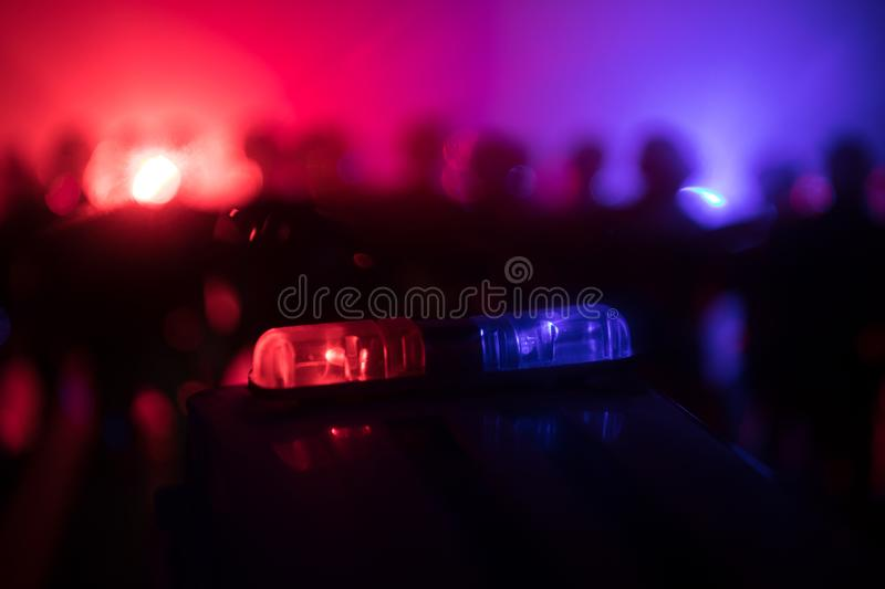 Anti-riot police give signal to be ready. Government power concept. Police in action. Smoke on a dark background with lights. Blue. Red flashing sirens stock photo