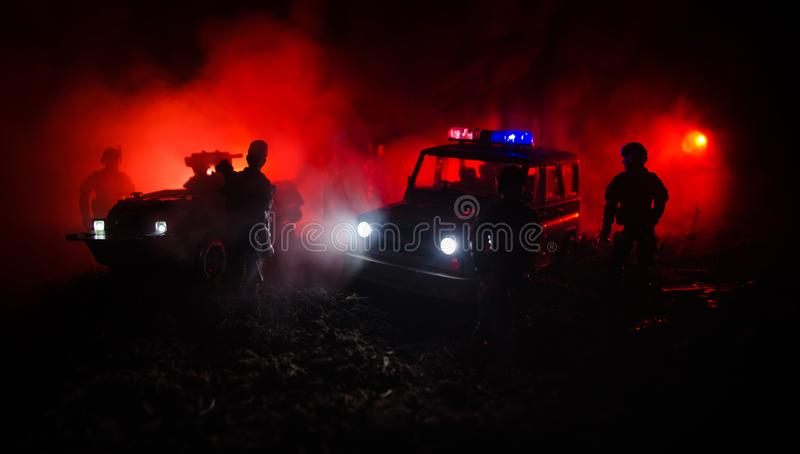 Anti-riot police give signal to be ready. Government power concept. Police in action. Smoke on a dark background with lights. Blue stock photos