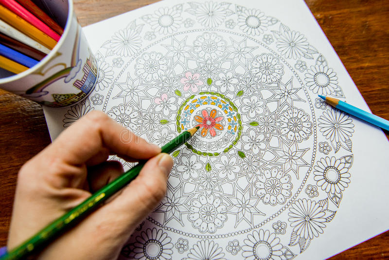 Anti-stress coloring book in the drawing process stock image