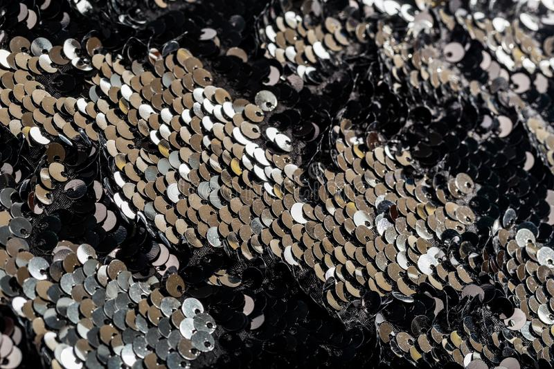 Anti-stress sequin surface background. Black and silver royalty free stock image