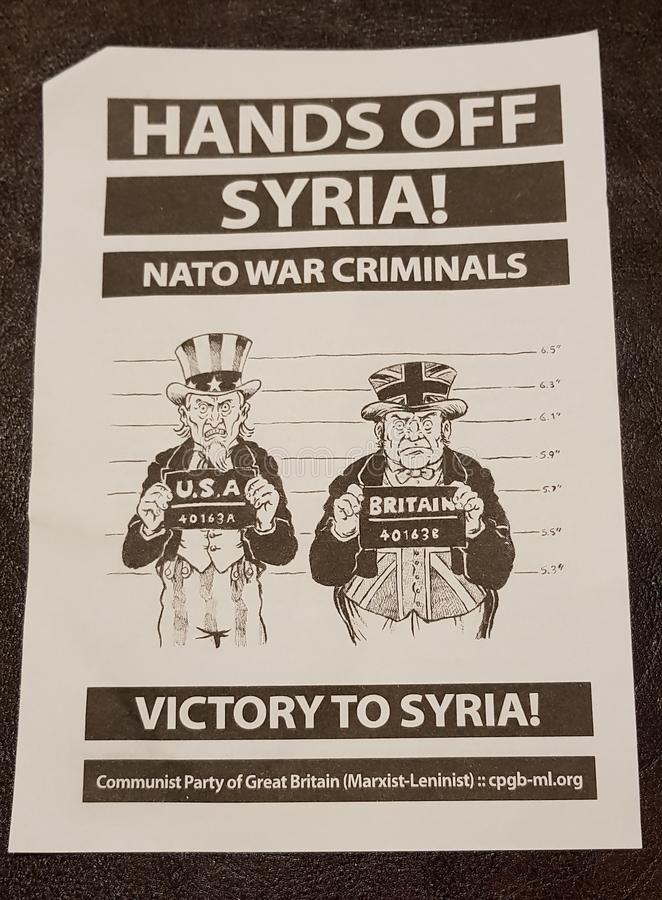 Anti Syria war flyers. Distributed by anti-war movements in Whitehall, London on 13 April 2018 stock photography