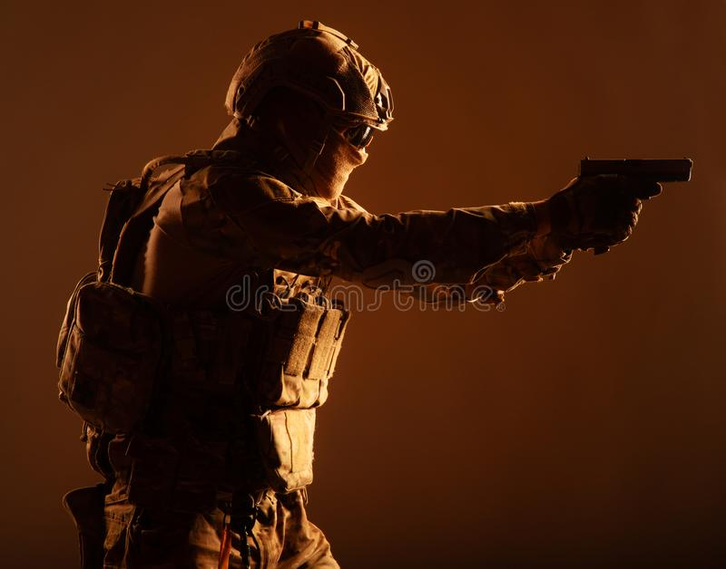Anti terrorist squad fighter aiming with pistol stock photography