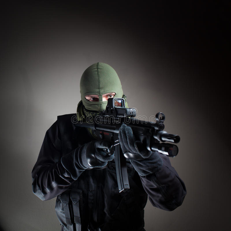 Anti terrorist unit policeman/soldier during the night operation. Special forces/ anti-terrorist police unit/private military/security contractor during night royalty free stock image