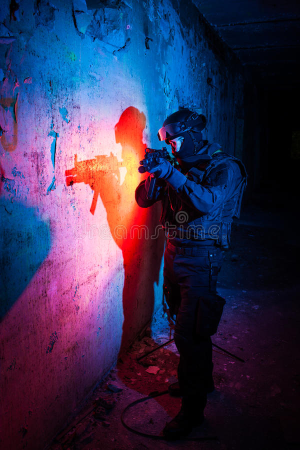 Anti-terrorist unit policeman/soldier. Special forces/ anti-terrorist police unit/private military contractor during night CQB hostage rescue raid/operation/ royalty free stock images