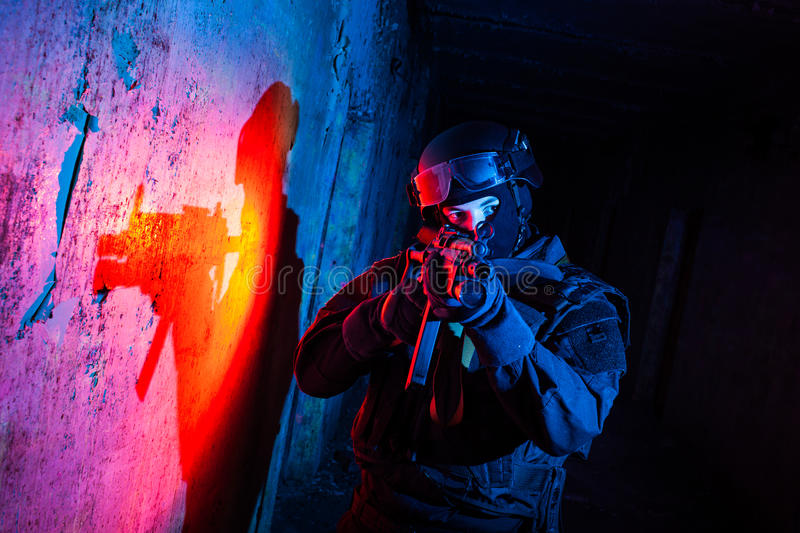 Anti-terrorist unit policeman/soldier. Special forces/ anti-terrorist police unit/private military contractor during night CQB hostage rescue raid/operation/ royalty free stock photos