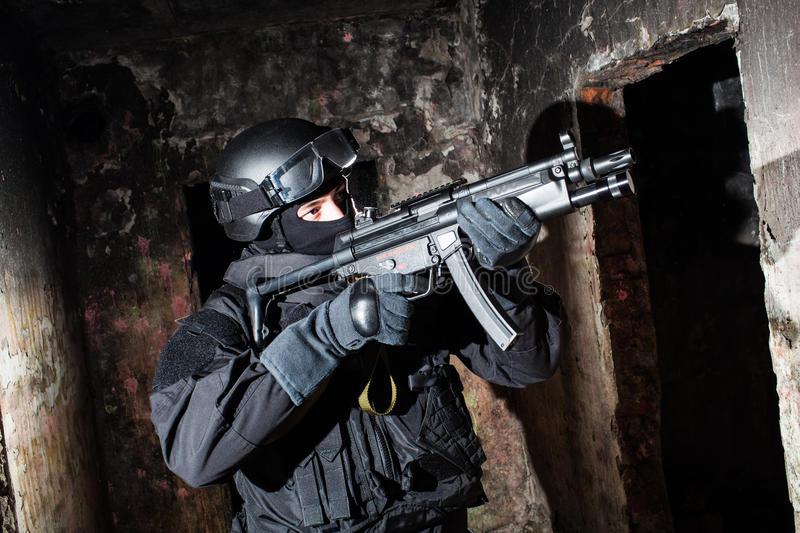 Anti-terrorist unit policeman/soldier. Special forces/ anti-terrorist police unit/private military contractor during night CQB hostage rescue raid/operation/ royalty free stock photo