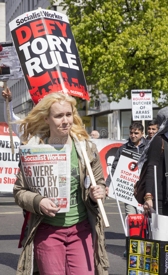 Anti-Tory at May Day Rally. London May 1 2016: A protester holds a placard 'Defy Tory Rule' - campaigning against the British Conservative Party (Tory) royalty free stock photo