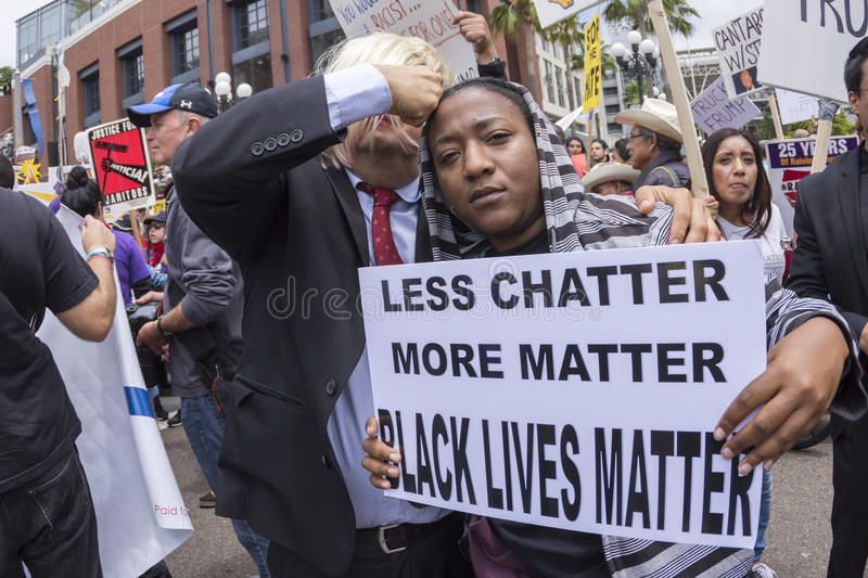 Anti-Trump protester with Black Lives Matter sign royalty free stock image