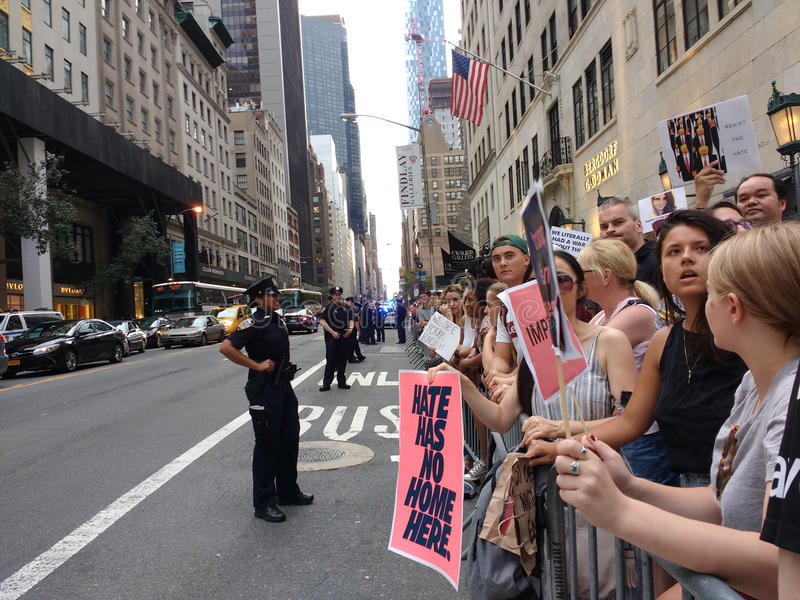 Anti-Trump Rally, Crowd of Demonstrator and Police, NYC, NY, USA. Protesters fill the streets surrounding Trump Tower in anticipation of the President`s first royalty free stock image