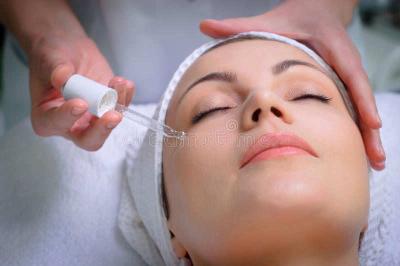 Anti-wrinkle skin treatment at beauty salon royalty free stock photo