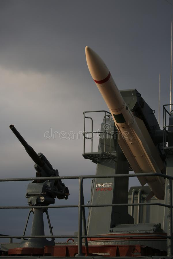 Antiaircraft missile system URAGAN and salute gun on a background of a dark cloudy sky royalty free stock images