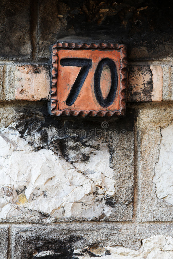 Antibes #5. Number of a house against a brick wall. Copy space stock photo