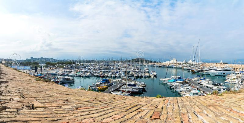 Skyline and Vauban port in Antibes. Antibes, France - July 01, 2016: wide angle view of port Vauban and skyline in Antibes, France. Port Vauban is the largest royalty free stock image