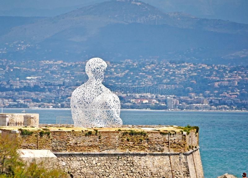 Antibes, France - June 16, 2014: Bastion Saint Jaume. Antibes, France - June 16, 2014: Nomade by Jaume Plensa, Bastion Saint Jaume royalty free stock image