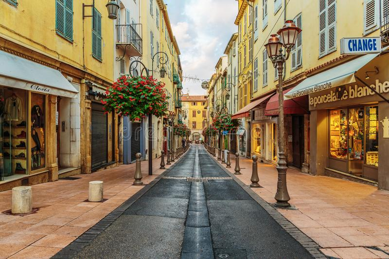 Street in the old town Antibes in France. ANTIBES, FRANCE - NOVEMBER 3, 2014: Street in the old town royalty free stock photography
