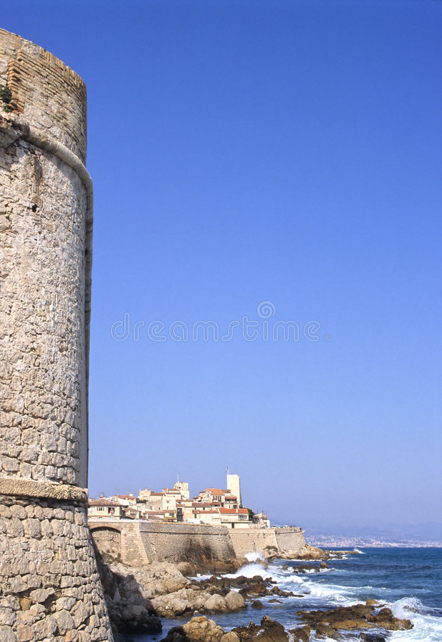 Antibes ramparts. Antique city of Antibes, in french riviera, showing tower, ramparts, sea and Nice city as background royalty free stock photos