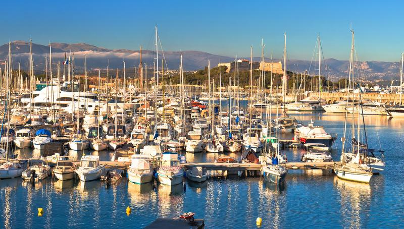 Antibes waterfront and Port Vauban harbor panoramic view. Alps background, Southern France royalty free stock photo