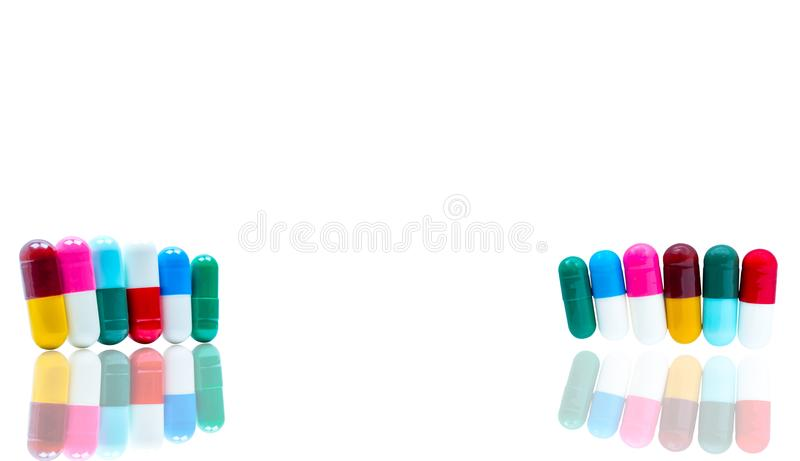 Antibiotic capsules pills in a row on white background with shad. Ows and copy space. Drug resistance concept. Antibiotics drug use with reasonable and global royalty free stock photos