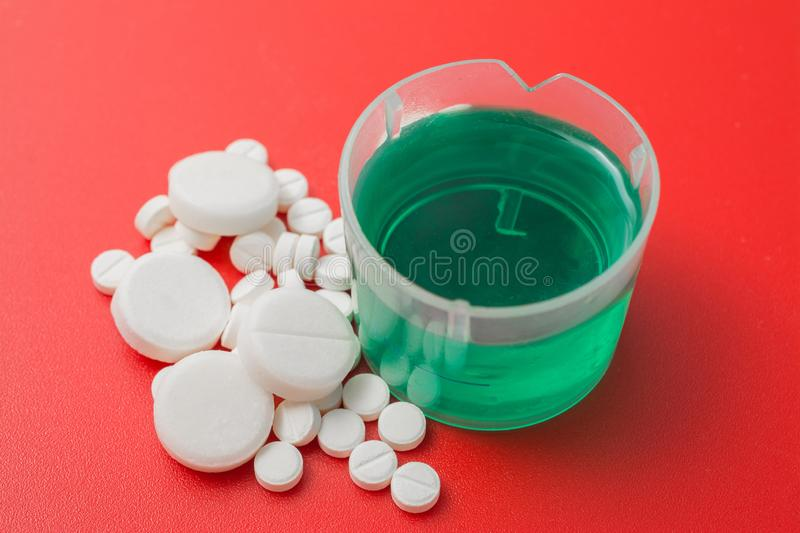 antibiotics and green liquid to treat a cold royalty free stock photography