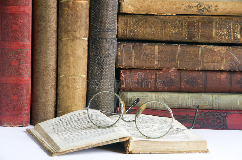 Antic books 2. Pile of old antic books with eyeglasses royalty free stock image
