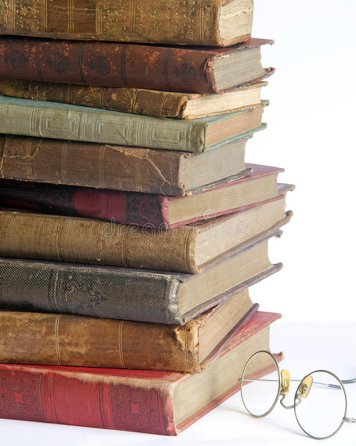 Antic books 4. Pile of old antic books with eyeglasses royalty free stock images