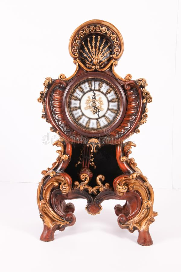 Antic clock. With brass engraved ornament decoration royalty free stock photos